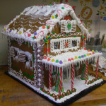 Gingerbread house with, candy cane pourch, and sweet candy roof